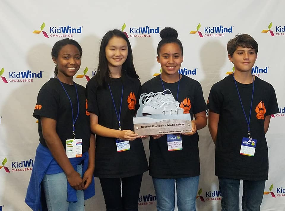 group of students holding trophy